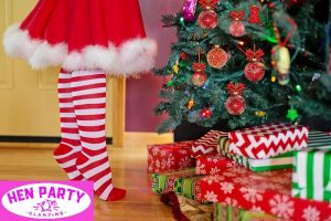 Christmas Tree and Gifts with girl in striped stockings